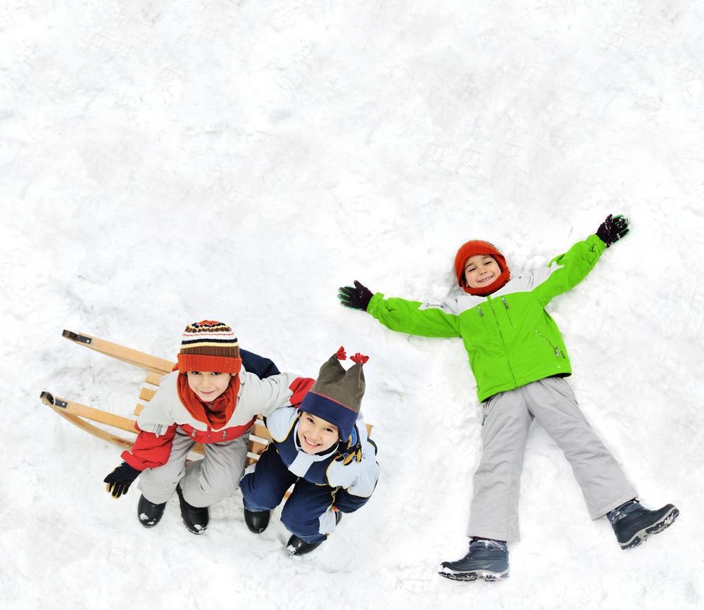 Happy kids with sledding on snow ground.jpeg